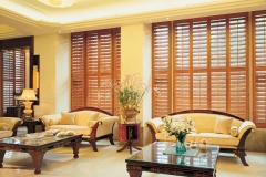 Lounge-full-length-golden-plantation-shutters