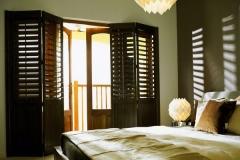 full-length-dark-wood-plantation-shutters