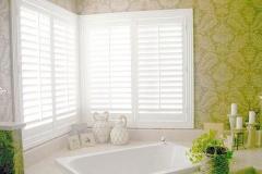 white-bathroom-plantation-shutters
