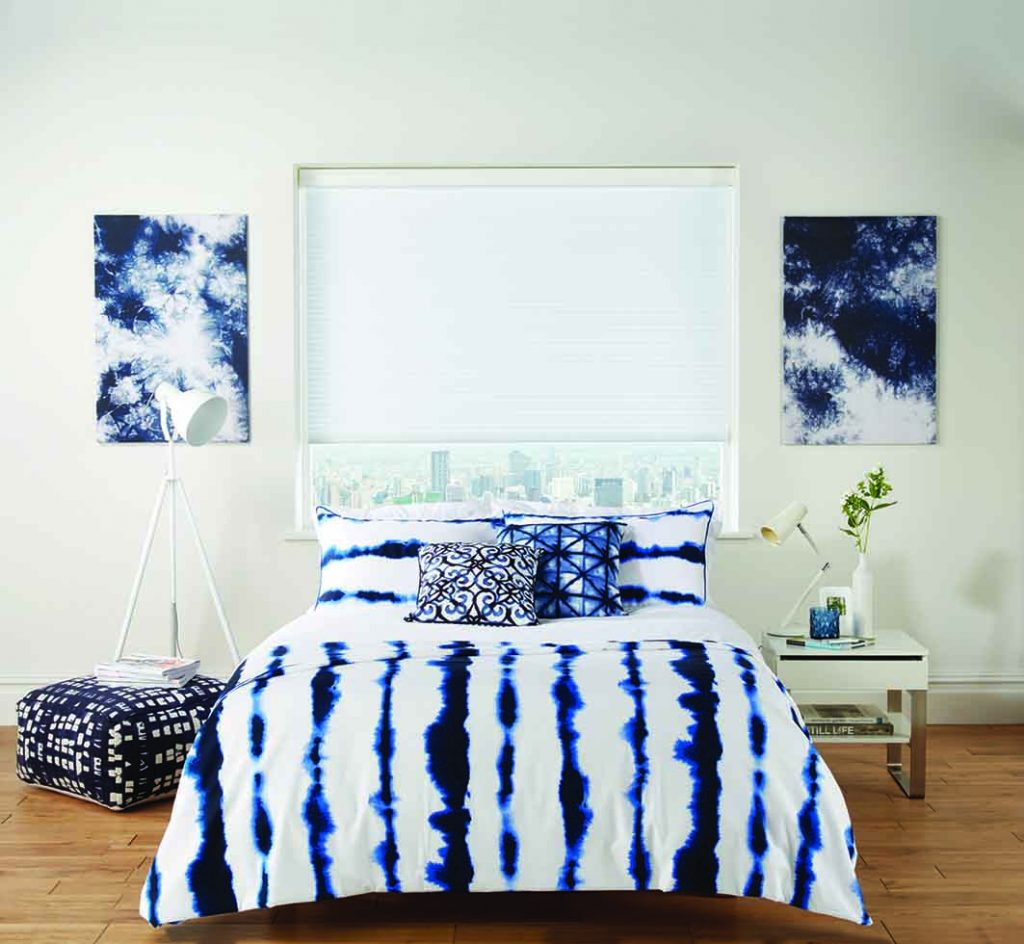 image of bedroom with white blinds